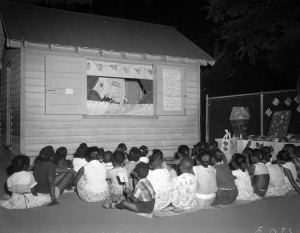 """""""  Children watching a puppet show, 28th & O Street playground"""" Adolph B. Rice Studio, August 11, 1958"""
